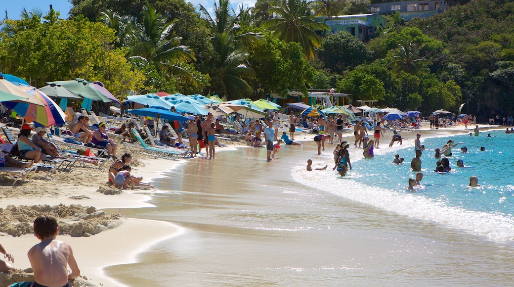 Coki Beach which includes a beach as well as a large group of people