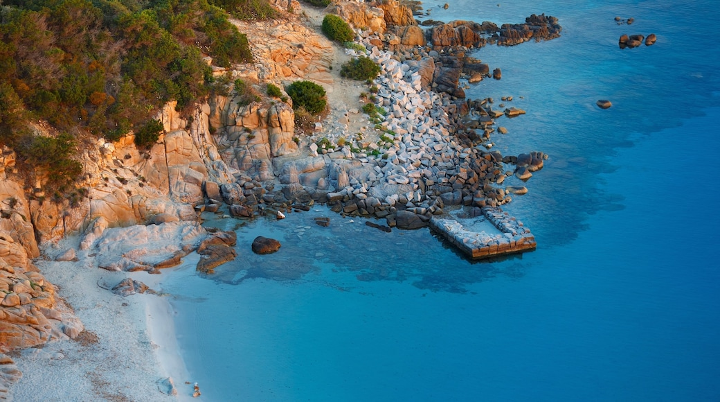 Villasimius which includes rocky coastline and a sunset