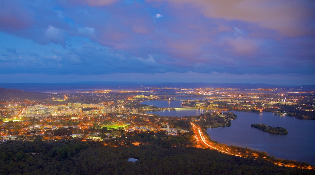Telstra Tower showing a city, a lake or waterhole and night scenes