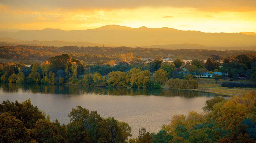 Canberra which includes a sunset, landscape views and a lake or waterhole