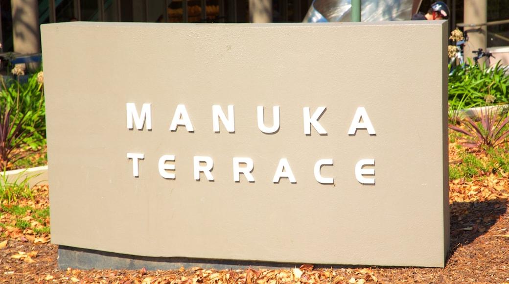 Manuka Shopping Centre featuring signage