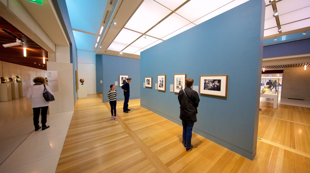 National Portrait Gallery showing interior views and art as well as a small group of people