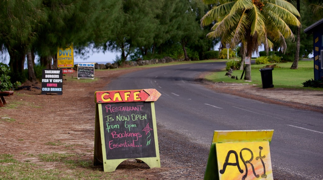Aro\'a Beach featuring signage