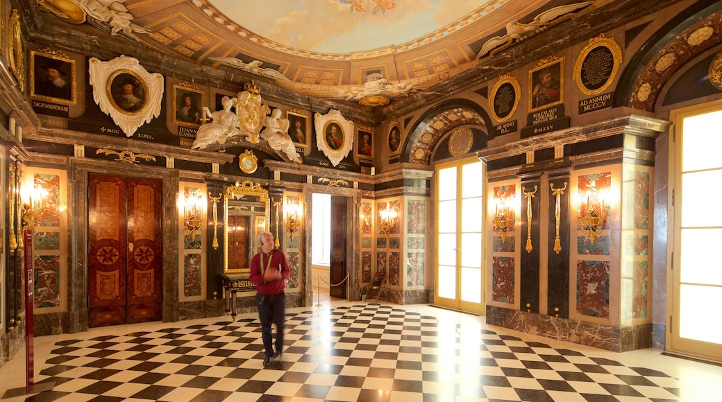Royal Castle featuring interior views, art and heritage elements