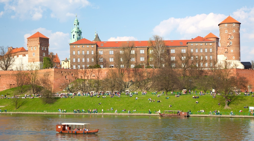 Wawel Castle which includes a castle and a river or creek