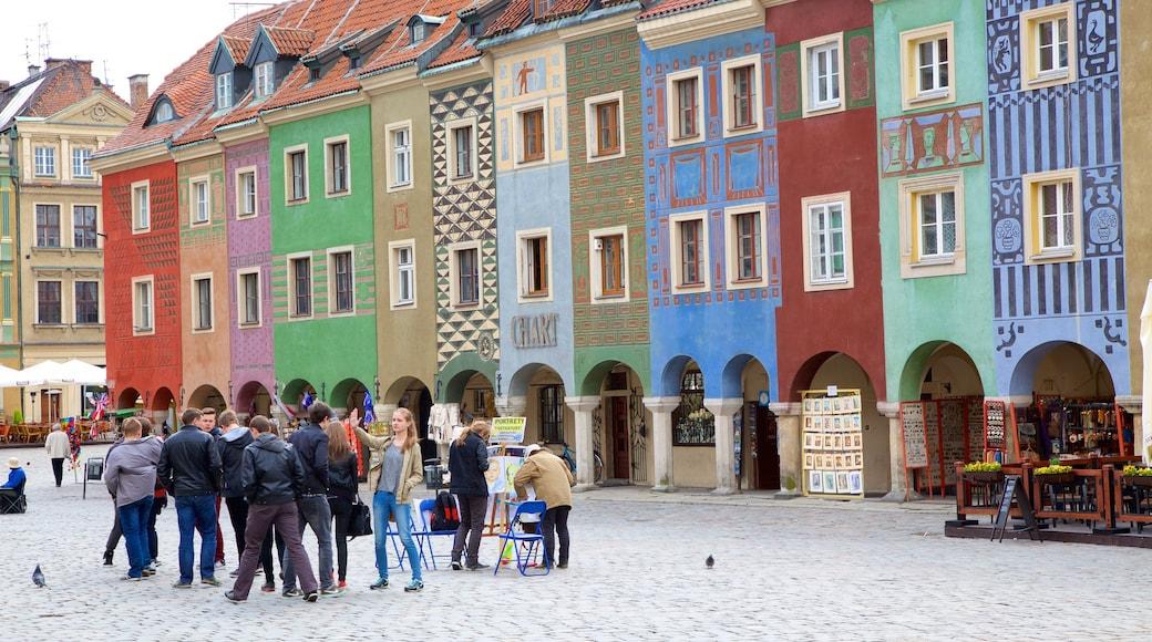 Stary Rynek welches beinhaltet Straßenszenen und Platz oder Plaza
