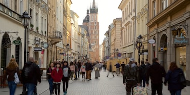 Krakow featuring heritage elements and a city as well as a large group of people