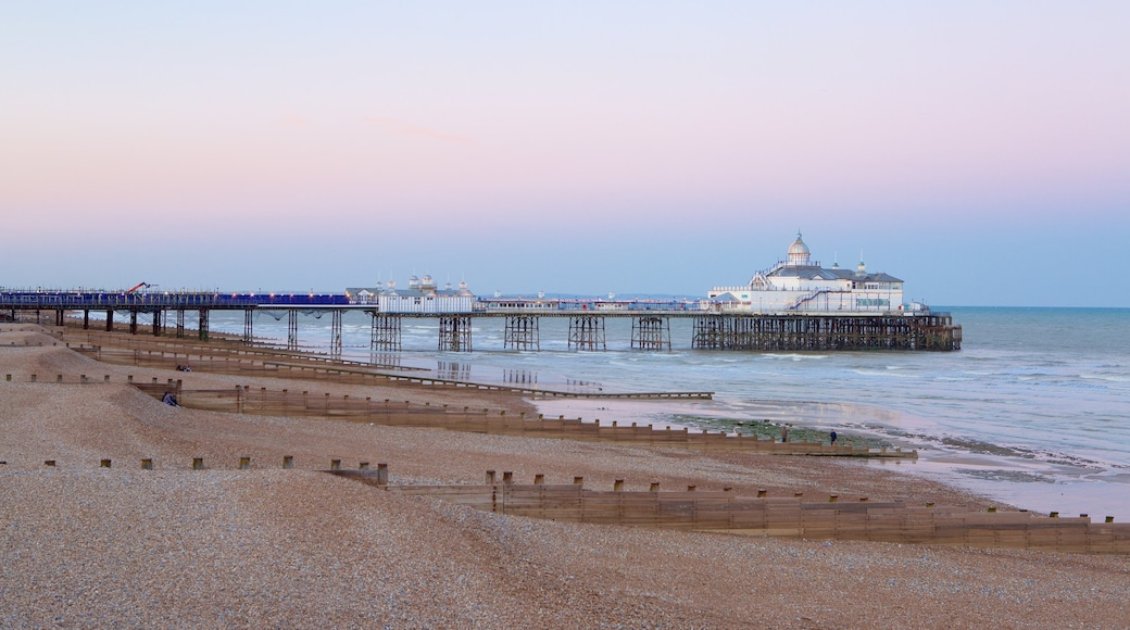 Eastbourne Pier which includes general coastal views and a sunset