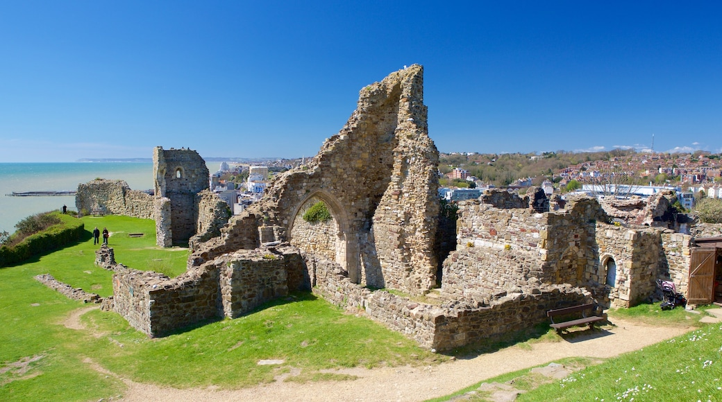 Hastings Castle featuring general coastal views, building ruins and heritage elements