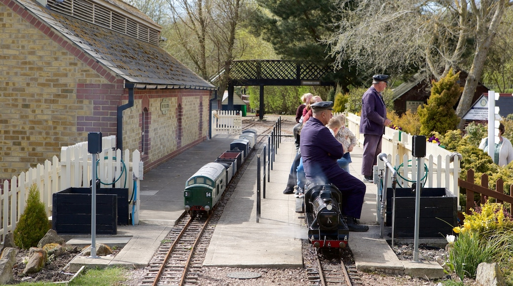 Eastbourne Miniature Steam Railway Adventure Park featuring railway items as well as a small group of people