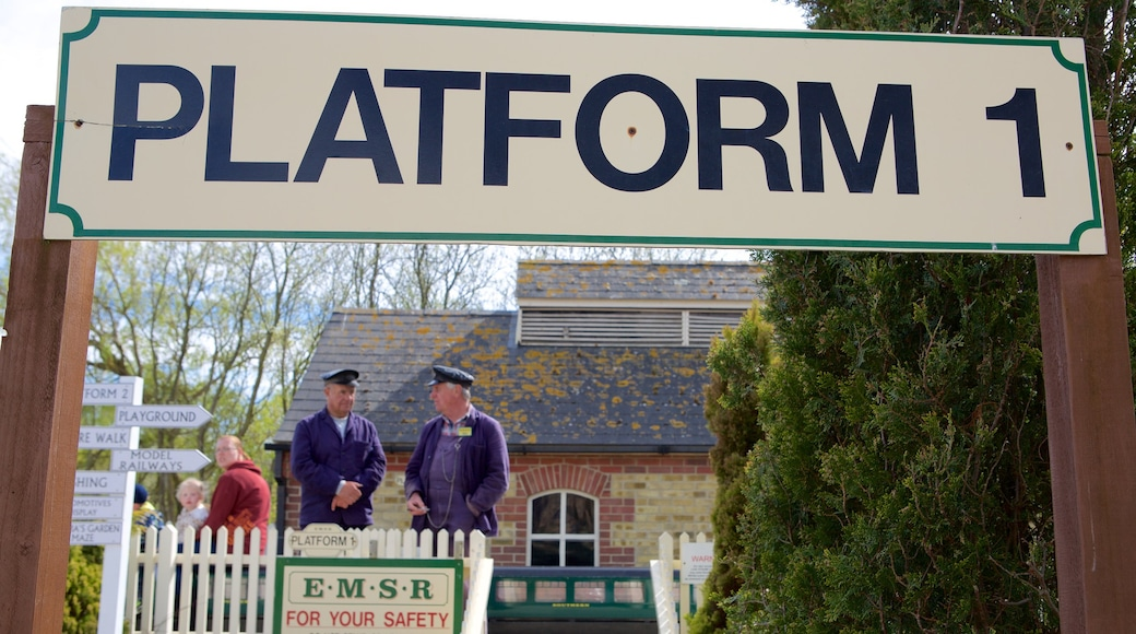 Eastbourne Miniature Steam Railway Adventure Park featuring signage and railway items as well as a small group of people