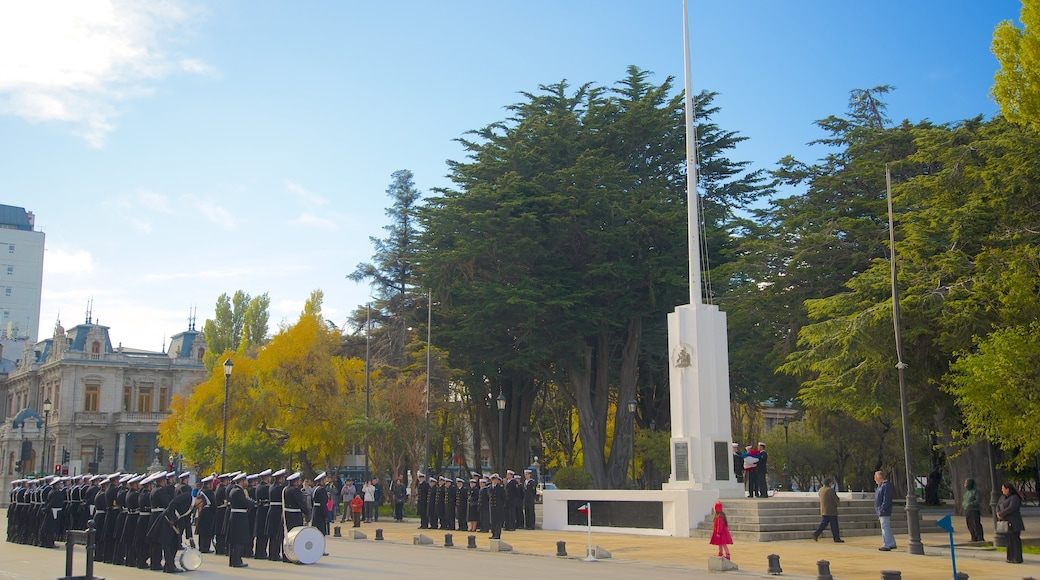 Punta Arenas which includes a park and military items as well as a large group of people