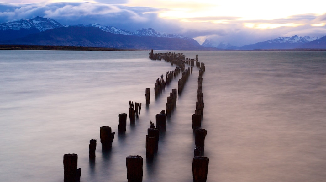 Puerto Natales showing landscape views, a lake or waterhole and a sunset