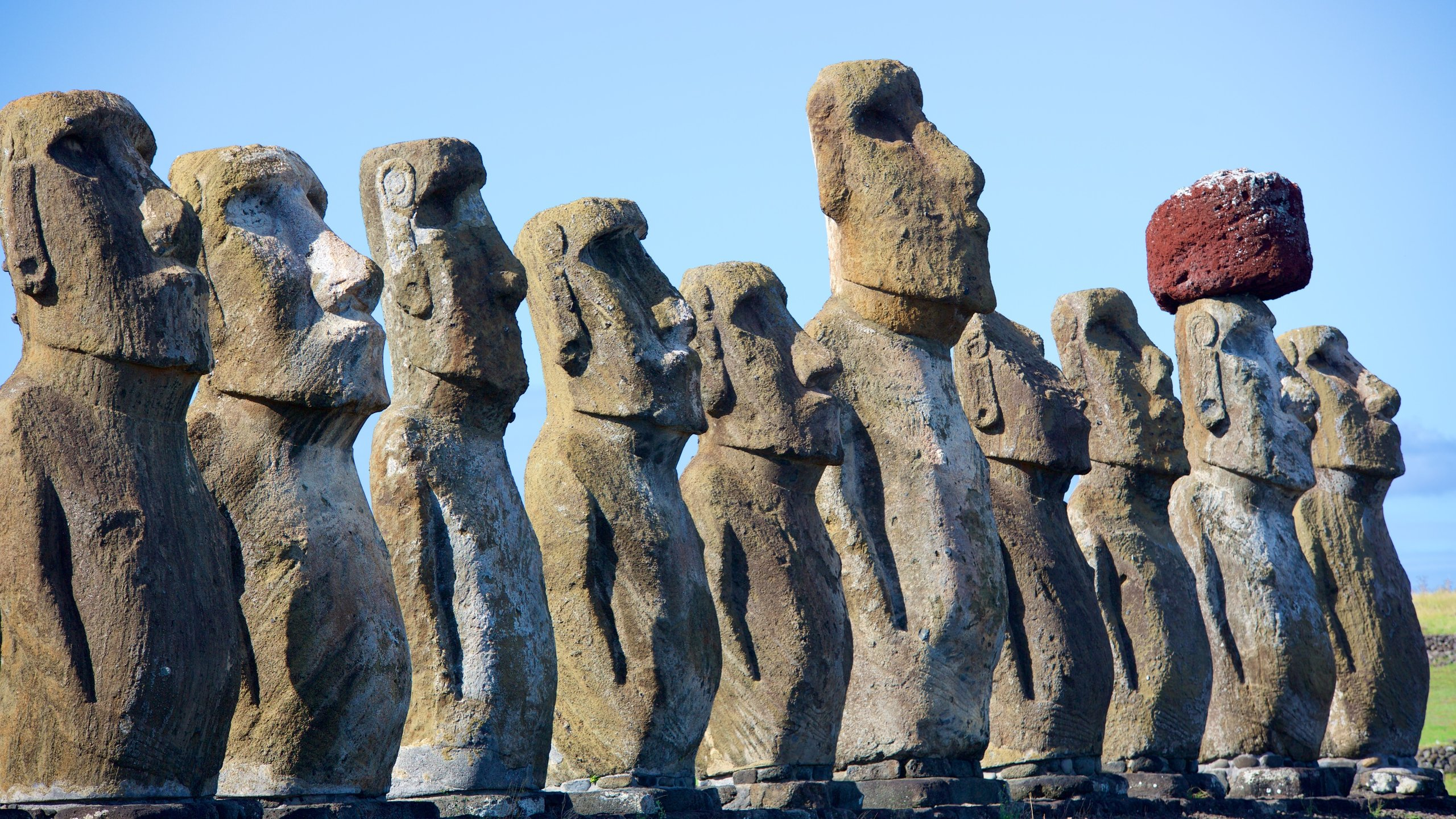 The largest of its type on Easter Island, this impressive ceremonial platform features 15 huge head-and-torso stone statues lined up in a row.
