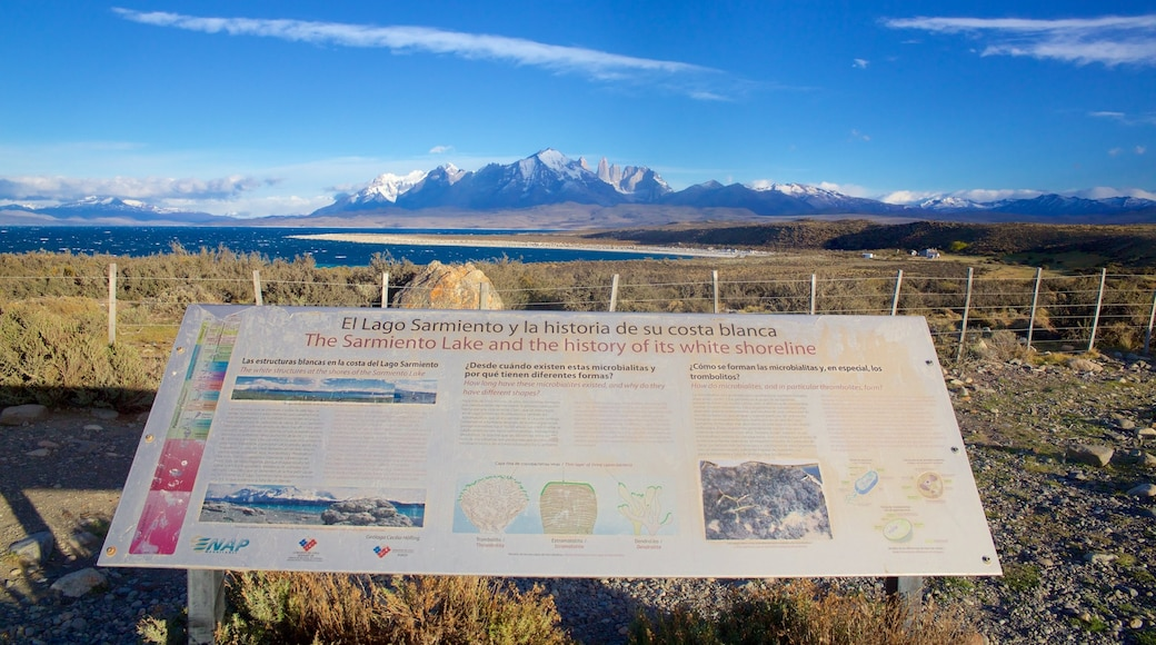 Torres Del Paine featuring tranquil scenes, a lake or waterhole and signage