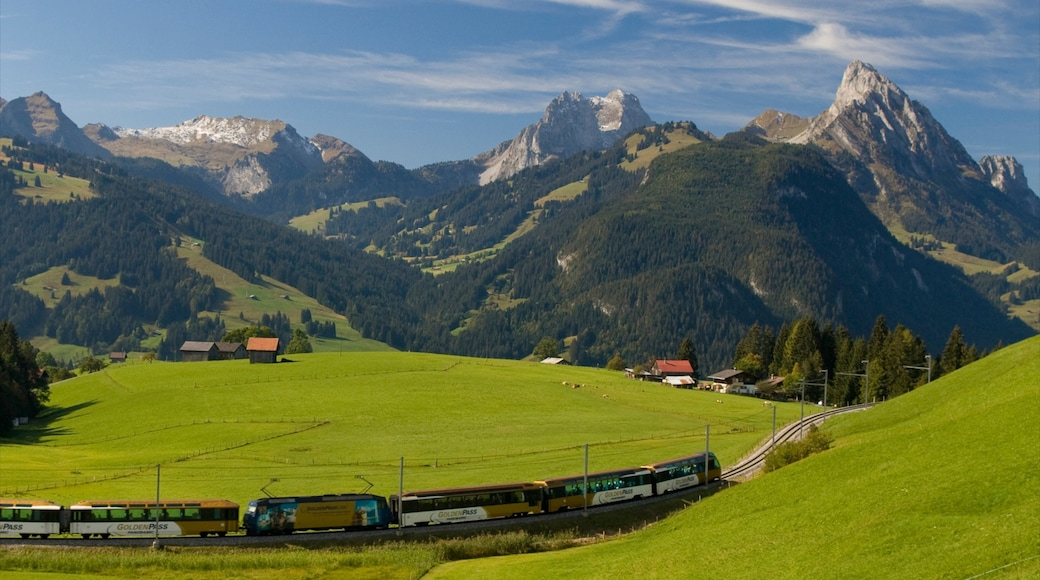 Gstaad montrant articles ferroviaires, scènes tranquilles et montagnes