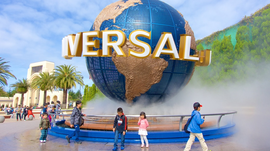 Universal Studios Japan® showing a fountain and a statue or sculpture as well as children