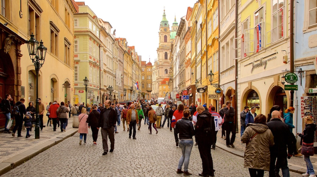 Prague showing a city and street scenes as well as a large group of people