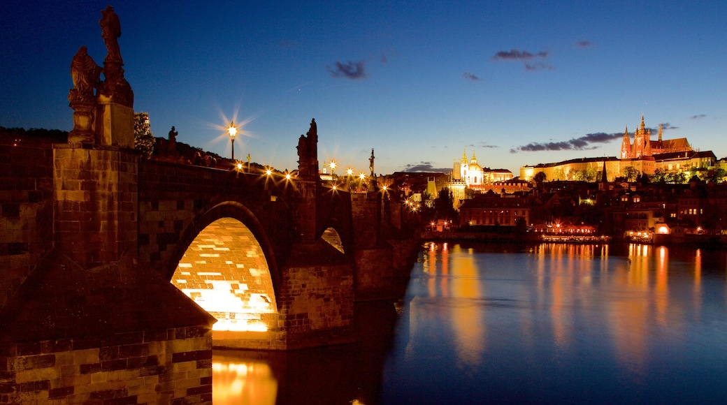 Charles Bridge featuring a bridge, a city and a river or creek