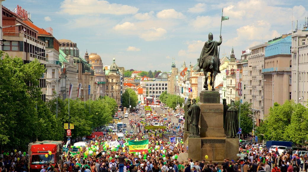 Wenceslas Square featuring a city, street scenes and a statue or sculpture