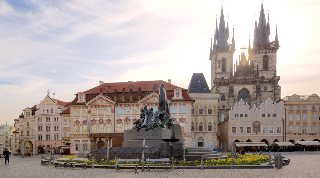 Tyn Church which includes a city, a statue or sculpture and a square or plaza