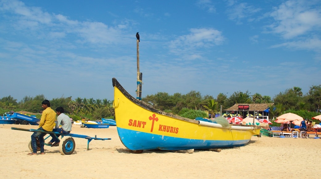 Calangute Beach showing a sandy beach and general coastal views as well as a small group of people