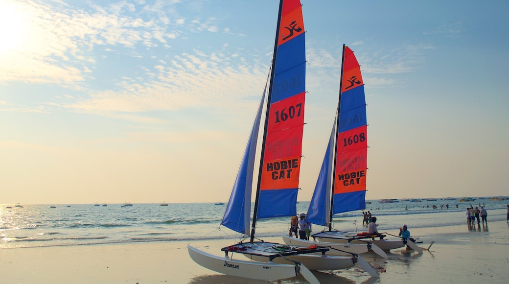 Baga Beach showing sailing, a sandy beach and a sunset