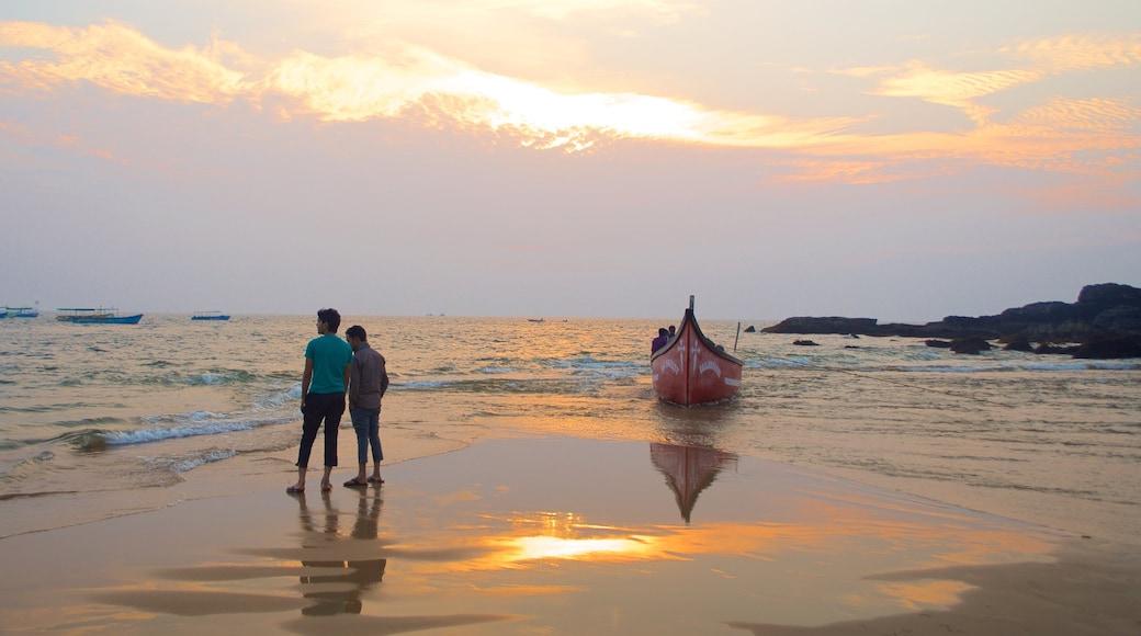 Baga Beach showing general coastal views, a sunset and boating