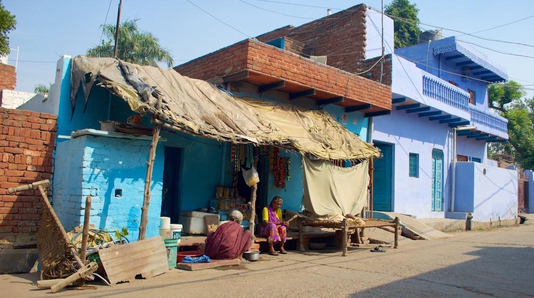 Chini ka Rauza featuring a house as well as a couple
