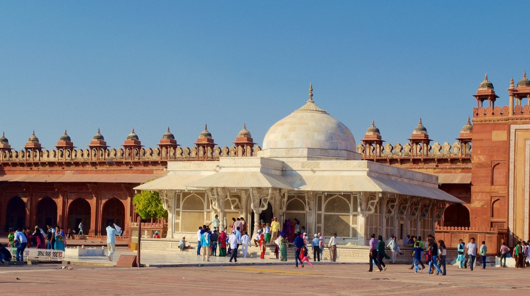 Fatehpur Sikri featuring a mosque and a square or plaza as well as a large group of people