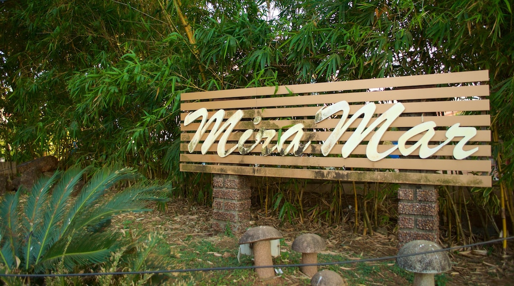 Miramar Beach which includes signage and forest scenes