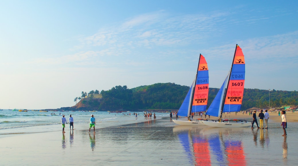 Baga Beach which includes sailing, a sandy beach and general coastal views