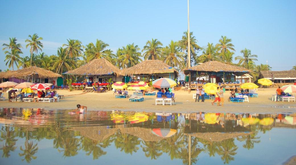 Baga Beach showing a beach, a beach bar and general coastal views
