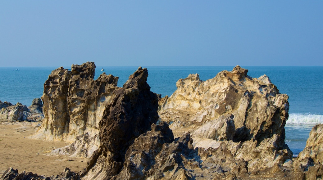 Vagator Beach featuring rugged coastline and general coastal views