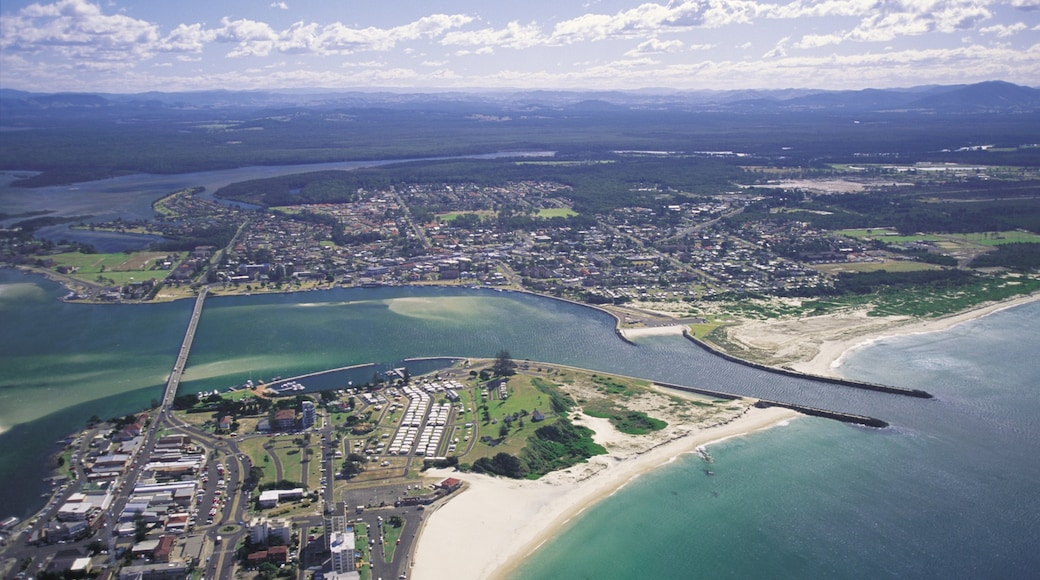 Forster which includes general coastal views, a sandy beach and a coastal town
