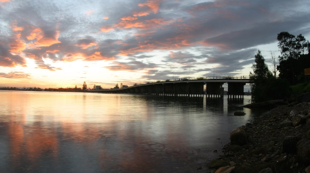 Forster which includes a bridge, a sunset and a river or creek