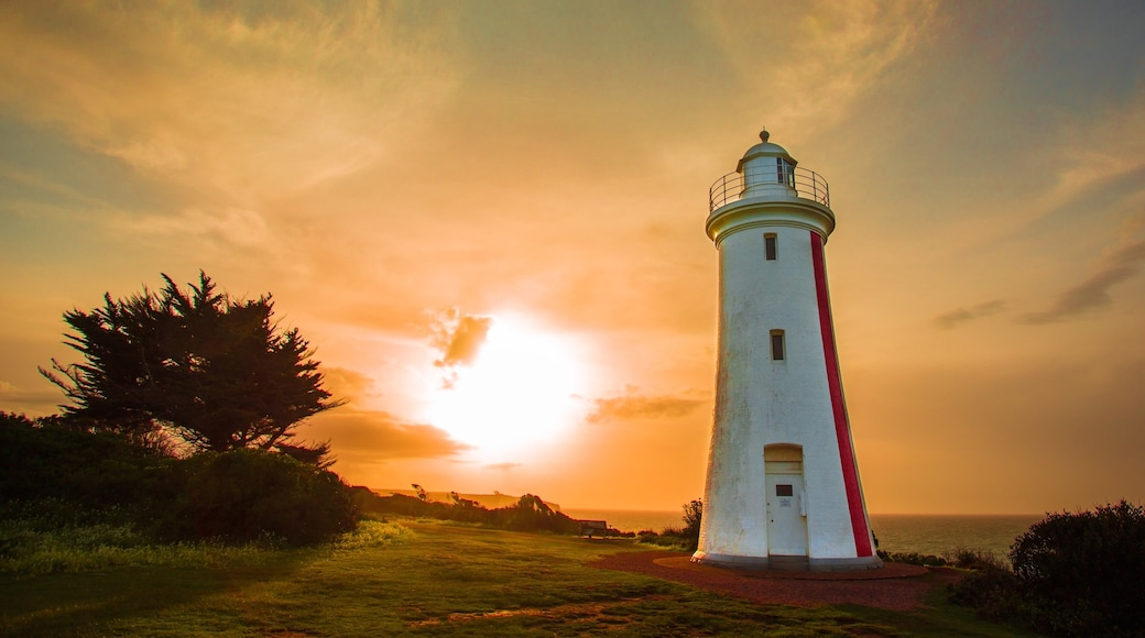 Devonport showing a lighthouse, general coastal views and a sunset