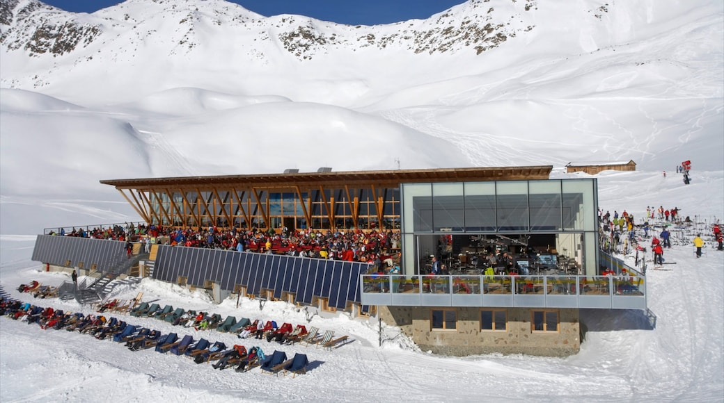 Serfaus featuring snow and a luxury hotel or resort as well as a large group of people