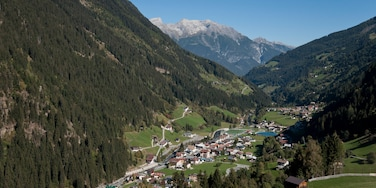 See featuring a small town or village and mountains