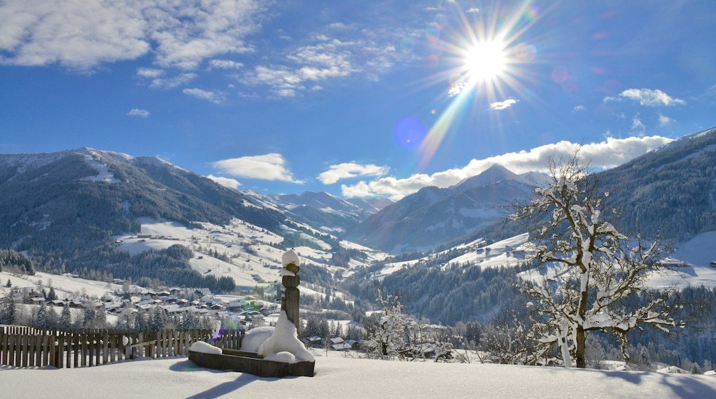 Alpbach showing mountains, a sunset and snow