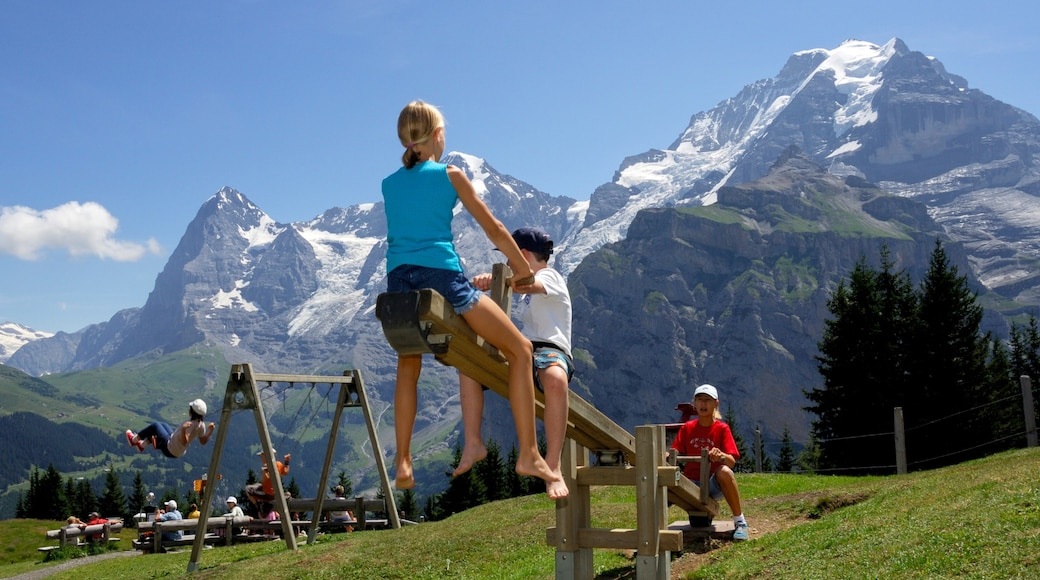 Muerren featuring mountains and a playground as well as children