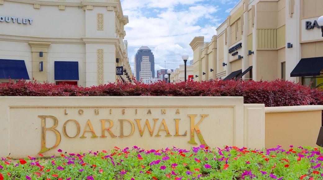 Louisiana Boardwalk showing signage and flowers