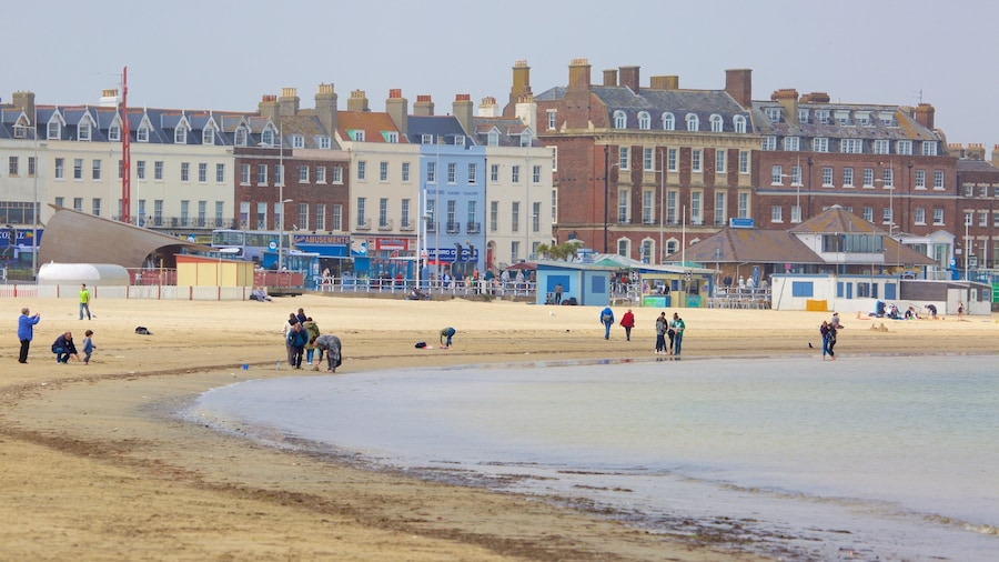 Weymouth which includes a sandy beach and heritage architecture as well as a small group of people