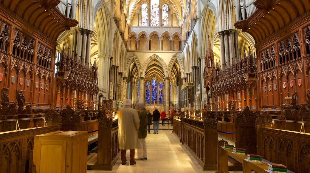 Salisbury Cathedral featuring a church or cathedral, religious elements and interior views