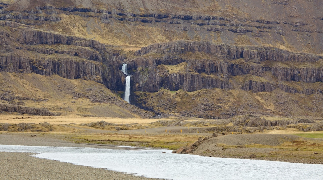 East Iceland which includes mountains, general coastal views and a cascade