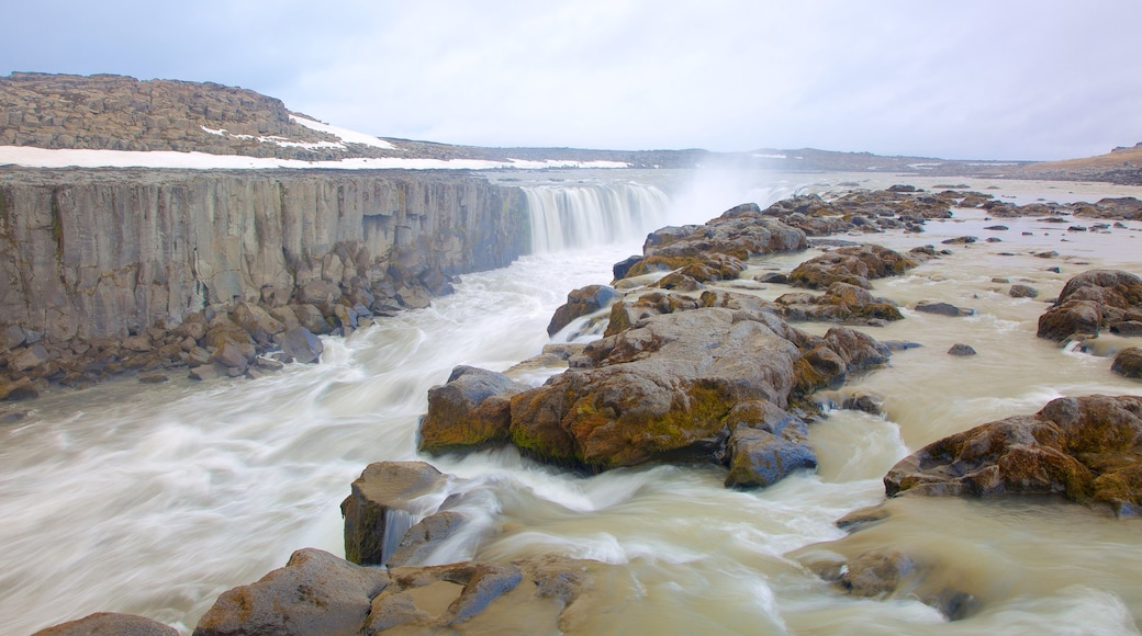 Selfoss featuring a gorge or canyon, rapids and snow