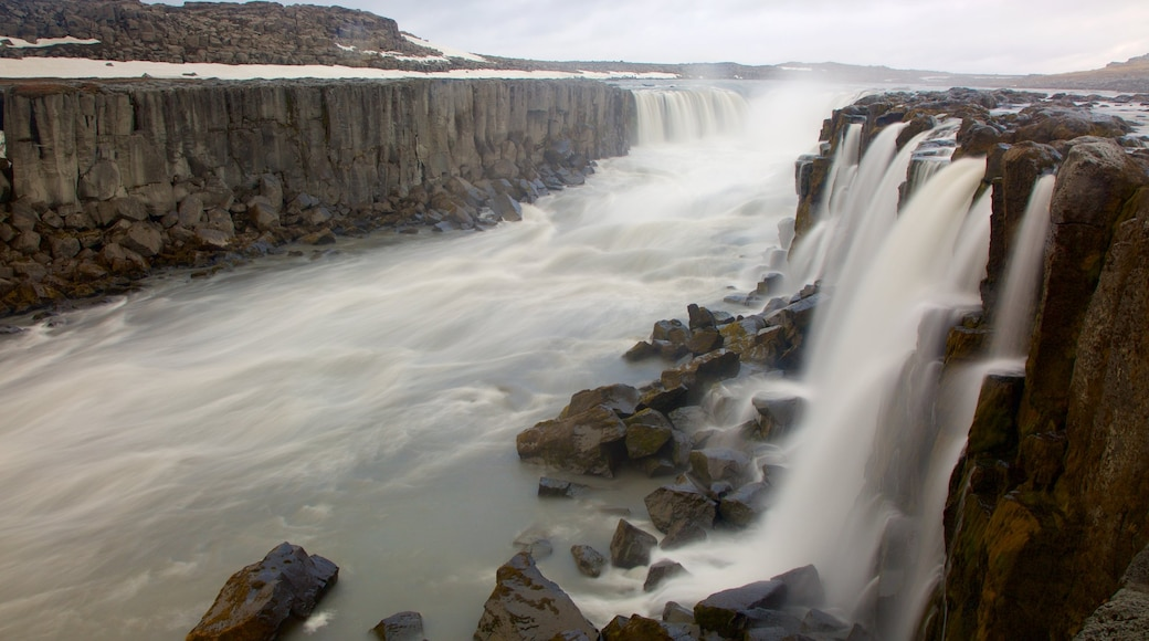 Selfoss featuring a cascade, rapids and a gorge or canyon
