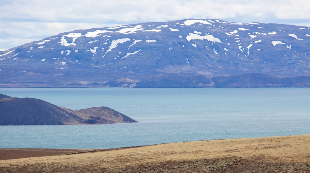 Thingvellir National Park which includes snow, mountains and general coastal views