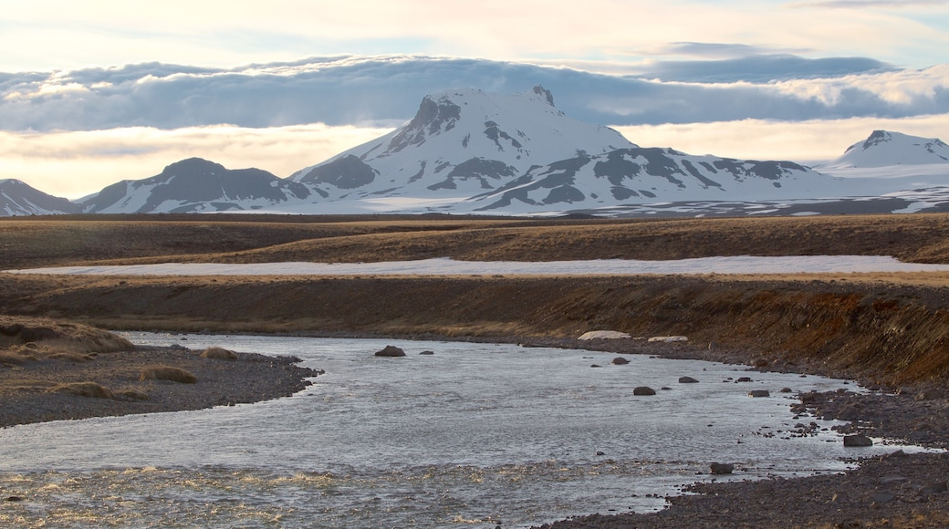 Iceland featuring mountains, snow and a river or creek
