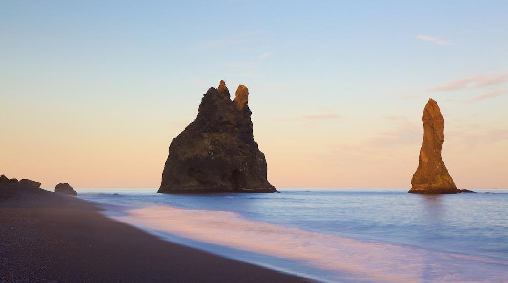 Reynisdrangar showing a sunset and a sandy beach